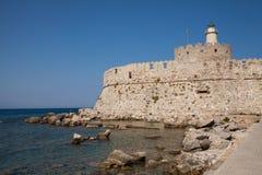 Крепость Санта Клауса на пристани в гавани Mandraki Стоковая Фотография