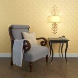 кресло около стены Стоковые Фото