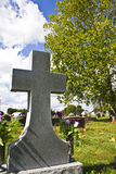 Крест в кладбище Стоковые Изображения