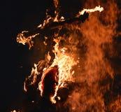 Крест в огне стоковое фото