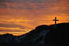 Крест на заходе солнца Стоковая Фотография