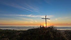 Крест ручки захода солнца Стоковая Фотография