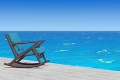 Кресло-качалка обитая с голубой тканью на деревянном поле в f Стоковые Фотографии RF