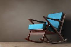 Кресло-качалка обитая с голубой тканью перевод 3d Стоковое Изображение