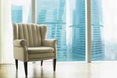 Кресло против большого окна Стоковое Фото