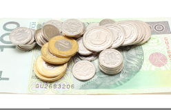 Кредитка и монетки на белой предпосылке Стоковое Изображение