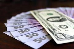Кредитки доллара и grivnas  Стоковое Изображение