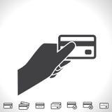 Кредитная карточка в значке вектора руки Стоковые Фото