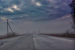 Кривая в тумане Стоковая Фотография