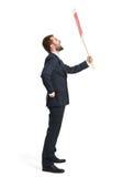 Кричащий бизнесмен с плакатом Стоковые Изображения
