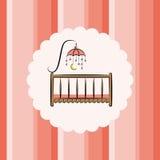 Кроватка младенца с игрушкой striped предпосылка Стоковое Изображение RF