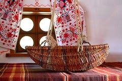 Кроватка младенца Wicker Стоковые Изображения