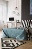 Кровать в студии стоковая фотография