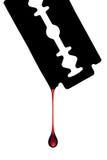 Кровь капая с лезвия бритвы Стоковое Фото