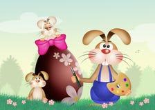 Кролик украшает пасхальное яйцо иллюстрация штока