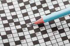 Кроссворд и карандаш крупного плана Стоковые Фото