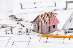 Крошечные дома строения людей для архитектурноакустических планов Концепция  Стоковое Изображение