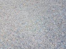 Крошечные серые и голубые камешки или гравий на том основании стоковые фото