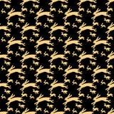Кролики золота бежать на твердой черной предпосылке Стоковая Фотография