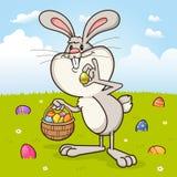 Кролик зайчика пасхи поставляя пасхальные яйца иллюстрация вектора