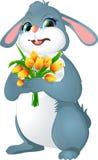 Кролик с желтыми тюльпанами Стоковое Изображение