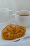 Круасант и кофе для завтрака Стоковое Изображение