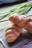 Круассан и колоски пшеницы Стоковые Фото
