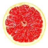 Круглый зрелый кусок грейпфрута на белизне изолировал предпосылку Стоковое Изображение