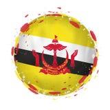 Круглый флаг grunge Бруней с брызгает в цвете флага бесплатная иллюстрация