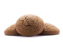 3 круглых печенья овсяной каши на белой предпосылке Стоковая Фотография