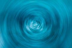 Круг конспекта голубой закручивая со случайными светлыми пятнами для предпосылки стоковые фото