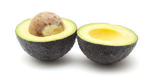 Круглой снятая кожу с темнотой груша авокадоа Стоковая Фотография