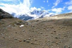 Круг пирамиды из камней на тропе природы Gamsgrube, Grossglockner Стоковое фото RF