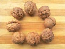 Круг раковины грецкого ореха на деревянной предпосылке Стоковая Фотография RF