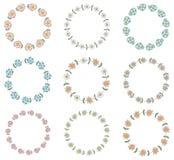 Круглые флористические венки с розовыми и голубыми цветками Иллюстрация штока