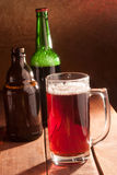 Кружка и бутылки пива Стоковая Фотография