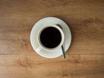 Кружка кофе на деревянном столе Стоковая Фотография