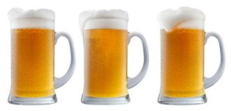 Кружка морозного пива с пеной Стоковые Изображения