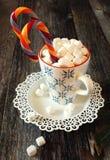 Кружка Нового Года с конфетой Стоковые Фото
