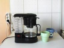 кружки создателя кофе Стоковые Фотографии RF