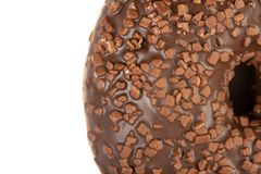 Крупный план донута со сливк отбензинивания шоколада стоковое фото