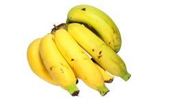 Крупный план желтого зрелого банана на белой предпосылке Стоковые Фото