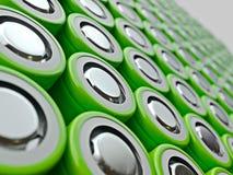 Крупный план зеленой кучи батарей li-иона Закройте вверх по красочным строкам выбора предпосылки конспекта энергии 18650 батарей Стоковая Фотография RF