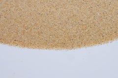 Крупный план картины предпосылки песка пляжа в лете Стоковые Фотографии RF