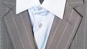 Крупный план кнопок и отворота костюма для дела или официально носки Стоковое фото RF