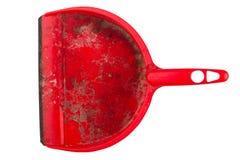 Крупный план пакостного красного dustpan на белой предпосылке Стоковое фото RF