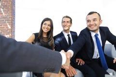 Крупный план партнеров рукопожатия дела Стоковое Изображение