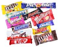 Крупный план различных адвокатских сословий шоколада на белизне Стоковое Изображение RF