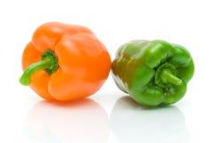 Крупный план сладостных перцев на белой предпосылке Стоковые Изображения
