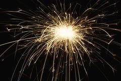 Крупный план бенгальского огня партии Нового Года на черной предпосылке Стоковые Изображения RF